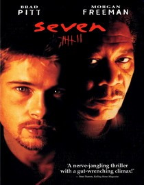 Movie poster with Brad Pitt and Morgan Freeman against a dark background.
