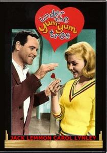 Man handing heart-shaped key to a woman.