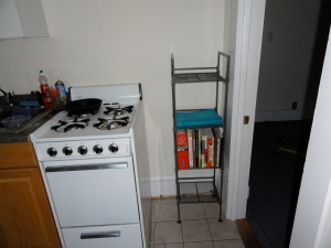 Shelf next to stove in kitchen.