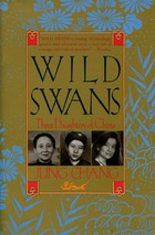 Brown cover with three female portraits on it.