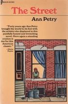 Black woman in red bandana in a window.