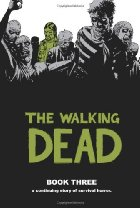 Zombies surrounding a man in green.