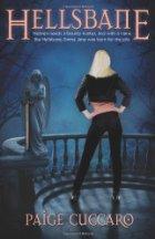 Blonde woman standing near statue of an angel.