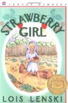 Girl in bonnet in a strawberry field.