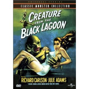 Creature from the Black Lagoon holding a woman in a white swimsuit.