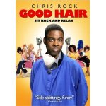Chris Rock standing in front of a row of women at a hair salon.