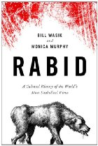Black, white, and red cover with image of a rabid dog.