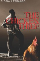Image of African man standing near a chicken.
