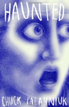 Purple and white face with large eyes and open mouth that looks frightened. Book title and author's name are written over it.