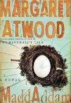An egg with a handprint on it sits in a nest. The title of the book and the author's name are in gold near it.