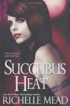 Read-headed pale woman standing seductively against a purplish-red backdrop.  The book title and author name are over her.