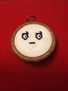 Cross-stitched version of the look of disapproval emoticon.