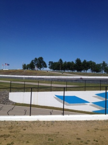 The motorcycle race track has many turns and elevation changes to be more interesting for the racers.