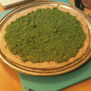 Garlic Scape Pesto on top of my pizza crust, before the rest of the toppings were added.