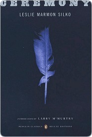 "Cover of the book ""Ceremony,"" features a blue feather on a blue background."