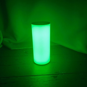 A glowing green lamp.