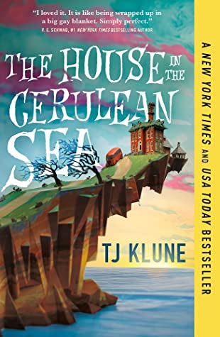 Digital image of the cover for The House in the Cerulean Sea. A cartoon drawing of a Victorian style home on a cliff over the ocean with two trees blowing in the breeze. A yellow bar on the side advertises that this is a New York Times and USA Today bestseller.