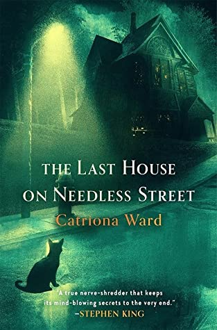 Image of a digital book cover. A green overtone street with a house looming in the background with no lights in the windows. A cat's silhouette sits in a streetlight.